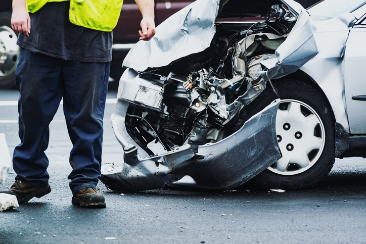 An emergency responder at the scene of a car accident